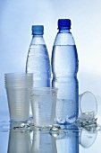 Bottles of water and plastic cups