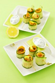 Cucumber and smoked salmon rolls with a dip