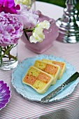 Three slices of Battenburg cake on a plate