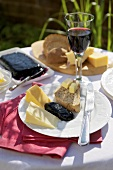 Cheese, bread, butter and blackcurrant jam