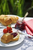 A bread roll with strawberry jam