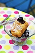 Ice cream in puff pastry with cherries