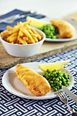 Beer-battered fish with peas and chips