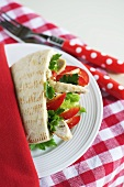 A pitta bread stuffed with chicken and pepper