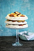 Pavlova with nectarines on a cake stand