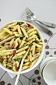 Penne with cream, peas and ham