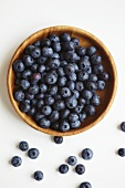 Blueberries in a wooden bowls, seen from above