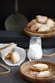 Drop-shaped almond shortbreads with icing sugar