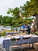 A buffet and a table laid for a midsummer party (Sweden)