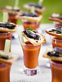 Vegetable soup in schnapps glasses with bread canapes