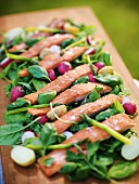 Oven baked rainbow trout with vanilla dresing on raw vegetables