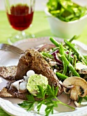 A minute steak with herb and anchovy butter and beans