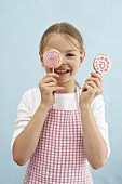 A girl with biscuit lollies