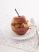 A baked apple with a bacon filling