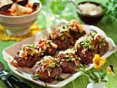 Game meat balls with a vegetable and apple topping