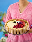 A summer tart with vanilla cream and berries