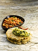 A dish from Maharashtra: mungo bean curry and bhakri (millet flatbread)