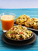 Upma (Indian semolina dish), toasted bread with pepper and sweetcorn and fruit juice