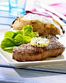 Rump steak with herb butter and a baked potato