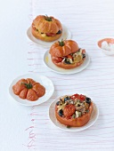 Three stuffed oxheart tomatoes with vegetarian filling