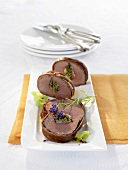 Several slices of beef fillet with herb stuffing