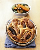 Toad-in-the-hole (sausages baked in batter) with baked vegetables