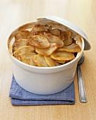 Lamb and potato hotpot in casserole dish