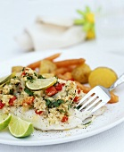 Cod with herb crust, lime wedges, potatoes and carrots