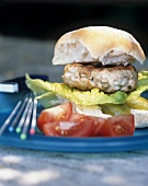 Turkey burger with gherkin, lettuce and tomato