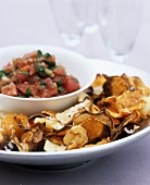 Parsnip and potato crisps with tomato salsa