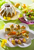 Stuffed eggs and ham rolls on an Easter table