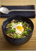 Clear vegetable soup with udon noodles, mushrooms & quail's egg