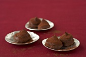 Several chilli truffles on metal dishes