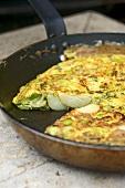 Potato tortilla in a frying pan