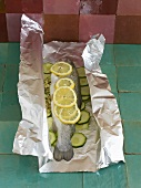 Whole trout with apple and mint stuffing in aluminium foil