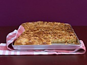 Tray-baked cake with almonds on a baking tray