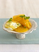 Dish of orange salad with pistachios and saffron cream