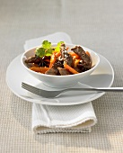 Fried strips of beef fillet, carrots, star anise & grated coconut