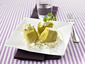 Three artichoke hearts with apple cream