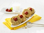 Four oat biscuits with raspberries