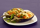 Stuffed aubergines with melted cheese topping (India)
