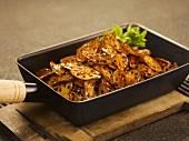 Crispy slices of lotus root in a frying pan