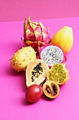An assortment of exotic fruits, whole and halved
