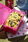 Pasta salad in a plastic box