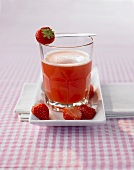 A glass of strawberry and passion fruit drink