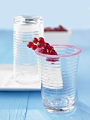 Redcurrants on a glass with a sugared rim