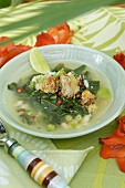 Crab soup with vegetables and lime