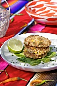 Three chicken and vegetable burgers in a pile (Mexico)