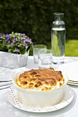 Herb soufflé in a baking dish out of doors