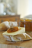 Cheese and mango chutney on a slice of baguette